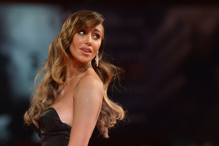 """Argentinian model Belen Rodriguez arrives for the screening of the movie """"Pasolini"""" presented in competition at the 71st Venice Film Festival on September 4, 2014 at Venice Lido.  AFP PHOTO / TIZIANA FABI        (Photo credit should read TIZIANA FABI/AFP/Getty Images)"""