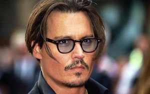 -...US actor Johnny Depp arrives at London's Leicester Square on June 29, 2009, to attend the British Premiere of his latest film 'Public Enemies'. AFP PHOTO/Max Nash (Photo credit should read MAX NASH/AFP/Getty Images)